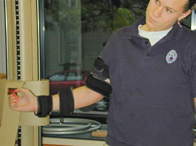 Patient with post operative elbow splint allows her to exercise without pain